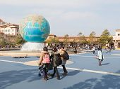 People Walk At A Theme Park