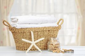 foto of pegging  - Basket of laundry with pegs - JPG