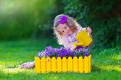 picture of pot plant  - Child working in the garden - JPG
