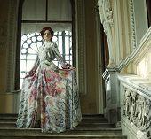 foto of stairway  - Beautiful woman standing on the top of a stairway  - JPG