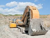 picture of excavator  - picture of a tracked excavator in a quarry - JPG