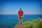 picture of mountain-climber  - rock climber on top of mountain - JPG