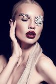 picture of fantastic  - fashion studio portrait of beautiful sexy woman with blond hair with fantastic makeup with bijou accessories - JPG