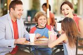 foto of 13 year old  - Family Enjoying Snack In Caf - JPG