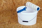 picture of lint  - set for painting bucket of white paint roller - JPG
