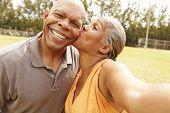 pic of two women taking cell phone  - Romantic Senior Couple Taking Selfie In Park - JPG