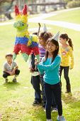 pic of pinata  - Children Hitting Pinata At Birthday Party - JPG