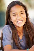 image of pre-adolescent girl  - Portrait Of Smiling Asian Girl - JPG