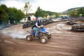 foto of mud  - young boy is facinated by quad driving - JPG
