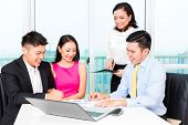 stock photo of counseling  - Asian banker team counseling client finance investment in bank office  - JPG