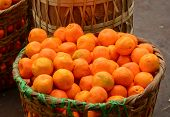 pic of yangon  - Real organic oranges at market stall in Yangon Myanmar. ** Note: Soft Focus at 100%, best at smaller sizes - JPG