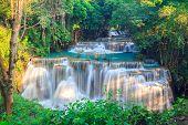 stock photo of waterfalls  - Waterfalls In Deep Forest at Huai Mae Khamin Waterfall in National Park Kanchanaburi Thailand - JPG