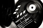picture of mm  - Movie clapper board on 35 mm movie reels in vintage black and white - JPG