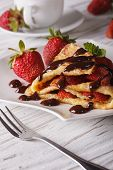 stock photo of crepes  - Delicious crepes with fresh strawberries and chocolate close - JPG