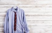 foto of composition  - Fathers day composition of shirt and tie hang on wooden wall background - JPG