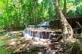picture of waterfalls  - Waterfalls In Deep Forest at Huai Mae Khamin Waterfall in National Park Kanchanaburi Thailand - JPG