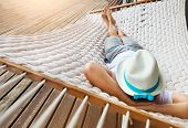 Man In Hat In A Hammock On A Summer Day poster