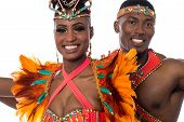 stock photo of samba  - Smiling samba dancing couple posing to camera - JPG