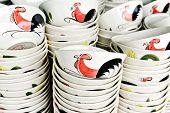 stock photo of roosters  - Ceramic rooster bowl from Lampang on sell in local marketThailand - JPG