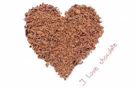 stock photo of grating  - Closeup of heart shaped grated chocolate with words I love chocolate valentine heart of chocolate I love chocolate concept - JPG