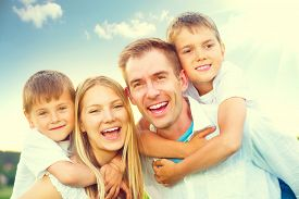 pic of hug  - Happy joyful young family father - JPG
