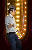 foto of peddlers  - young man with glass of wine near the mirror in cabaret - JPG