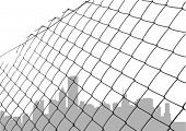 chain link fence with city silhouette