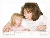 Mother Trying To Explain The Computer To Daughter