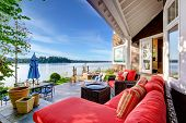 Luxury House Exterior With Impressive Water View And Cozy Patio Area. poster