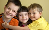 picture of happy kids  - sister with brothers having fun at home - JPG