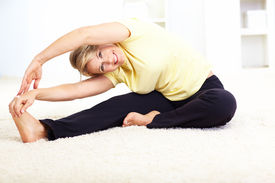 foto of workout-women  - Happy mature woman doing yoga - JPG