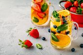 Infused Detox Water With Orange, Blueberry, Strawberry And Mint. Ice Cold Summer Coctail Or Lemonade poster