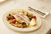 Fish fillet baked with vegetables, Italian dish