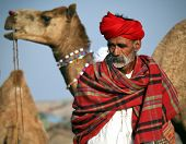 PUSHKAR, INDIA - NOVEMBER 18: An unidentified man attends the Pushkar fair on November 18, 2010 in Pushkar, Rajasthan, India. Pilgrims and camel traders flock to the holy town for the annual fair.