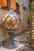 Close Up Of An Old Glass And Brass Street Lamp In The Old Town In Ulcinj, Montenegro poster