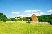 foto of splayed  - Mountainous landscape with a haystack - JPG