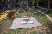 Picnic On Grass In Ancient Ruin. Japanese Style Picnic With Umbrellas And Small Table. Romantic Dinn poster