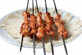 picture of doughy  - skewers with chicken satay on barbecue in close up - JPG