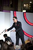 SOUTHAMPTON, UK - SEPT. 22: Gok Wan signs copies of his autobiography from the catwalk in West Quay