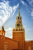 The Famous Spasskaya Tower Of Moscow Kremlin, Russia. Spasskaya Tower On The Blue Sky Background In  poster