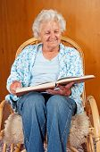 picture of broad-bodied  - Portrait of a senior woman in rocking chair - JPG