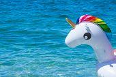 Unicorn Swim Tube On The Beach, Koh Lipe, Satun, Thailandinflatable Unicorn.fantasy Swim Ring For Su poster