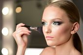 Glamour Makeup For Pretty Woman In Beauty Salon. Glamour Look With Makeup Brush. poster