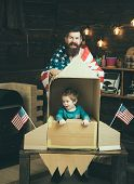American Cheerful Family With Usa Flags Play With Rocket Made Out Of Cardboard Box. Child Cute Boy P poster