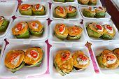 Thai Food Style, Steamed Curried Fish In A Banana Leaf Cup At Street Food,scomberomorus Curry Steame poster
