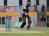 PUCHONG, MALAYSIA - SEPT 24: Malaysia's batsman Ahmad Faiz makes a run in this Pepsi ICC World Cricket League Div 6 finals vs Guernsey at the Kinrara Oval on September 24, 2011 in Puchong, Malaysia.