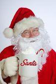 Santa Claus. Christmas Santa. Isolated on white. Room for text. Santa Claus holds a cup of Hot Coco  poster