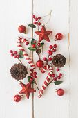 White Wood With Pine Cones Or Conifer Cone, Red Holly Balls, Glitter Star, Candy Cane And Bauble In  poster