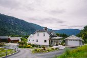Cityscape With White Spaced-out Traditional House In Norway. Norway House, Traditional Scandinavian  poster