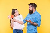 Share Sweets. Daughter And Dad Eat Candy. Bearded Hipster Man Is Good Father. Little Girl And Dad Co poster